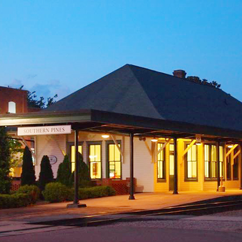 Night view of the Southern Pines depot.